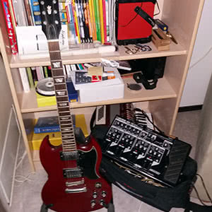 A Tokai guitar, a Boss pedal, and some other things.