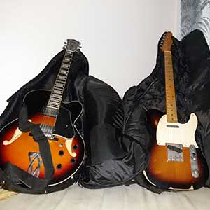 An Ibanez guitar and a Fender guitar.